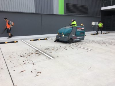 sweeping carpark at nundah